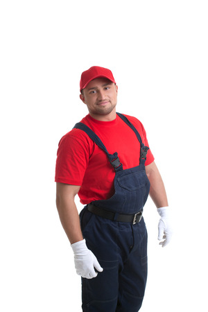 Image of smiling muscular man posing in workers suit photo