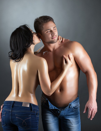 Portrait of sexy topless partners posing in studio, close-up photo