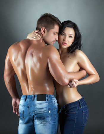 Sexy young married couple posing at camera, close-up photo