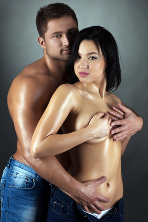 Beautiful tanned partners looking at camera, close-up photo