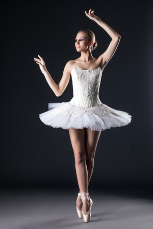 Image of attractive female ballet dancer posing in studio