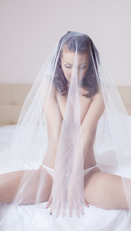 Image of shy beautiful bride posing topless photo