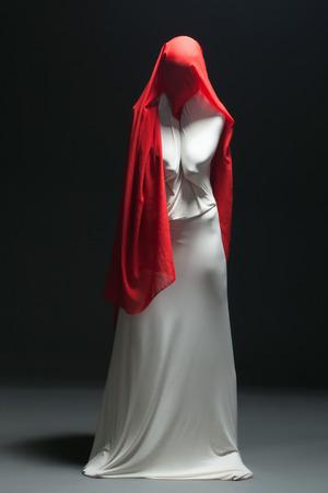 Metaphor for loneliness - faceless female dancer posing in studio