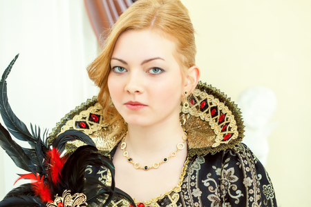 personage: Portrait of young red-haired royal personage, close-up
