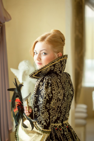 blonde woman: Image of pretty young actress posing in luxury dress
