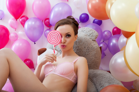 flirty: Image of flirty young brunette posing closed eyes lollipop Stock Photo