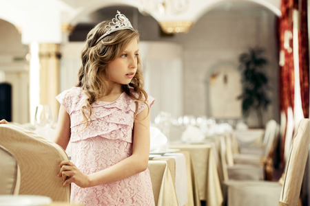 smartly: Image of smartly dressed little lady posing in restaurant Stock Photo