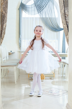 Image of amusing little girl posing in hotel restaurant Stock Photo