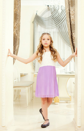 smartly: Image of smartly dressed proud girl posing in restaurant Stock Photo