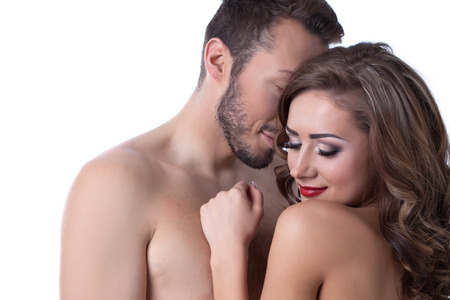 erotic couple: Sexy naked girl shyly hiding in arms of lover, close-up Stock Photo