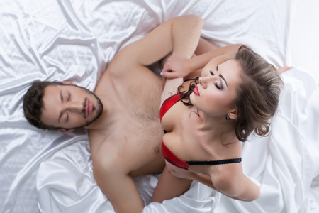 sex women: Top view of passionate young lovers having sex, close-up Stock Photo