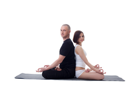 European couple doing yoga in studio, isolated on white photo