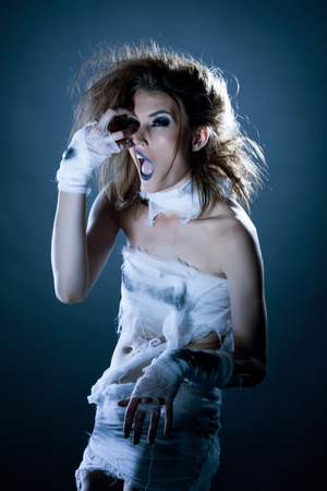 fashion photography: Fashion photography - pretty young model posing as mummy Stock Photo