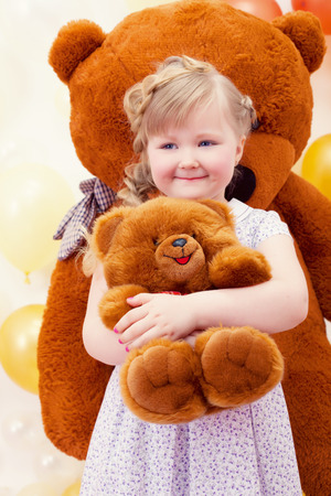 toy bear: Image of charming little girl hugging favorite toy