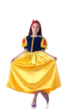 curtsy: Charming young girl dressed as Snow White doing curtsy Stock Photo