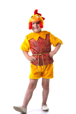 Image of funny little boy posing in cockerel suit photo