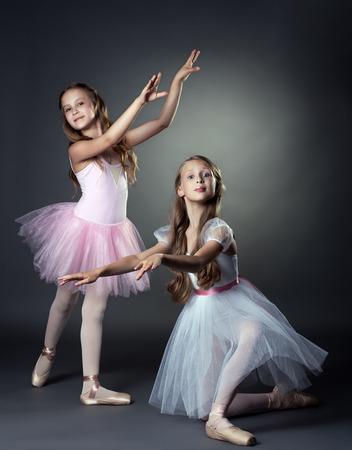 Image of emotional young ballerinas posing in studio photo