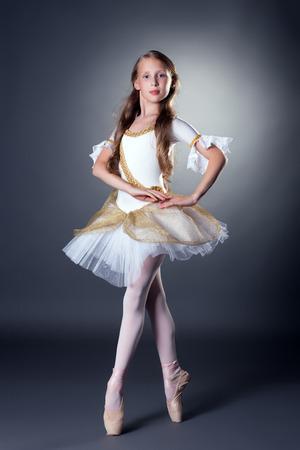 Image of graceful long-haired ballerina posing at camera photo