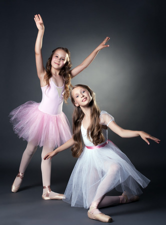 Image of two lovely ballerinas posing in studio