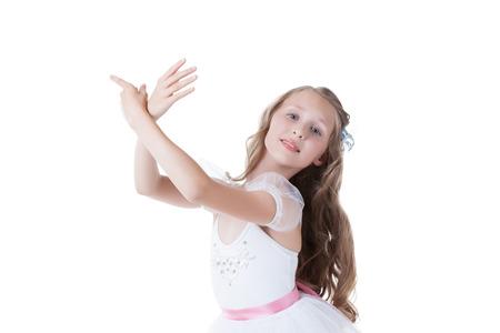 gracefully: Lovely ballerina gracefully posing at camera, isolated on white