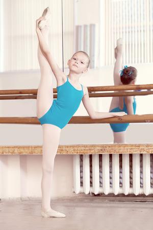 barre: Image of flexible young ballerina doing vertical split