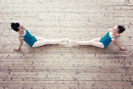 pointes: Top view of adorable little ballerinas posing in studio