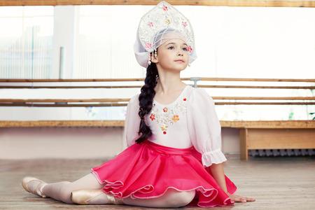 kokoshnik: Image of pretty young Russian ballerina posing in ballet class Stock Photo
