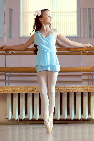 Image of lovely young ballerina posing in dance class photo
