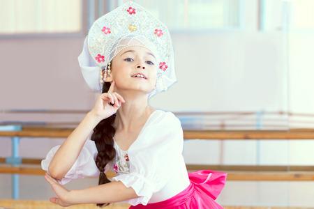 kokoshnik: Portrait of pretty little ballerina posing in Russian kokoshnik