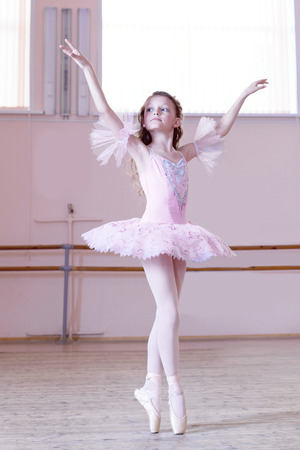barre: Ballet class  Petite ballerina dancing at camera