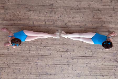 kids class: Ballet Studio  Top view of petite girls doing exercising Stock Photo