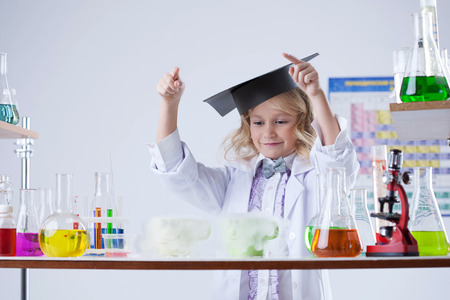 experimenter: Image of adorable little experimenter posing in lab, close-up