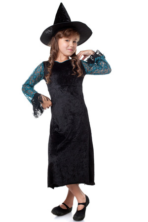 the enchantress: Image of elegant little girl posing dressed as witch Stock Photo