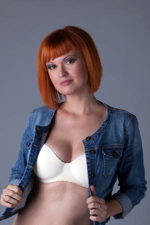 red bra: Hot redhead girl posing in seamless bra and denim jacket