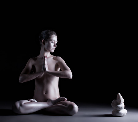 naked statue: Concept of Zen  Nude girl with shimmering skin meditates