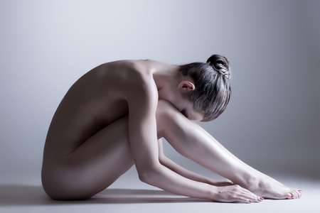 naked female body: Nude young woman posing at camera  Concept of inner calm