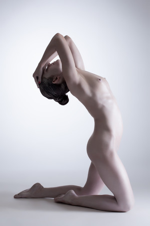 naked statue: Image of nude harmonous girl posing as statue in studio