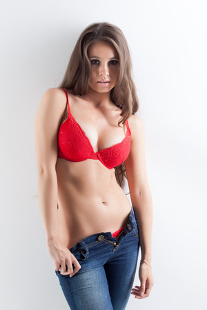 Image of sexy brunette posing in fashionable red underwear
