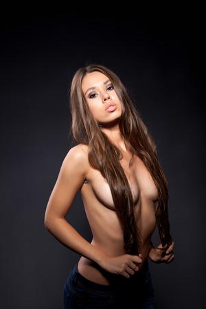 topless brunette: Sexy young girl posing topless covering her breasts hair