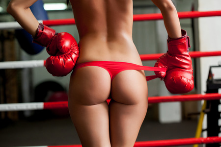 Image of elastic female boxer s ass in red thongs, close-up photo