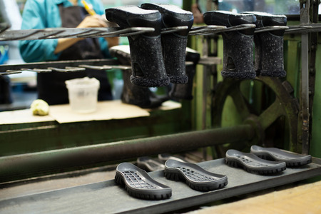 rubber plant: Image of footwear production - boots and rubber soles