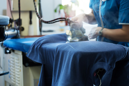 Image of laundry worker at work, close-up 스톡 콘텐츠
