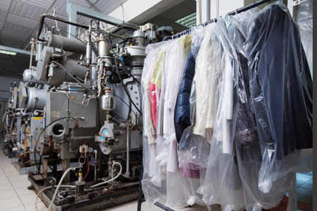 Image of clean packed clothes hanging in dry cleaning