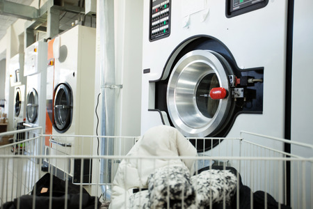 laundry: Image of modern washing machines in laundry room Stock Photo