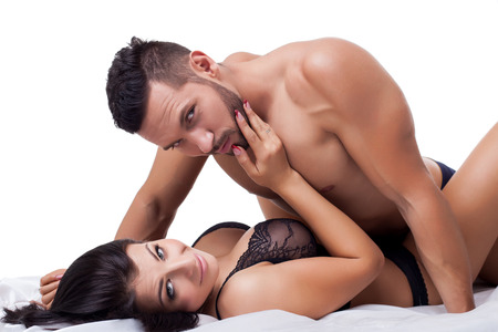 Beautiful lovers in bed posing at camera, close-up Stock Photo