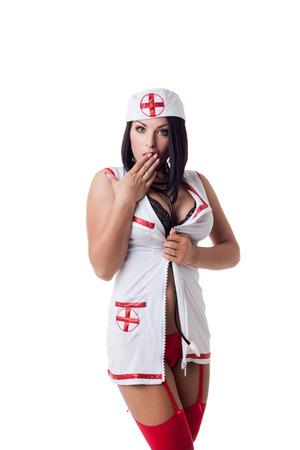 Sexy emotional nurse posing in stockings and garter Foto de archivo