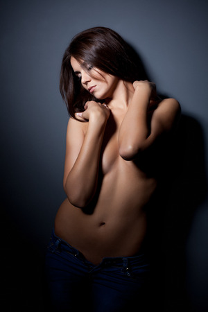 topless jeans: Portrait of beddable slim model posing topless in jeans