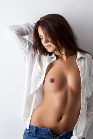 brunette naked: Image of seductive topless woman posing with eyes closed Stock Photo