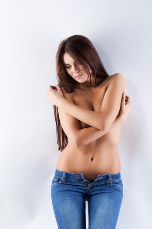 topless jeans: Portrait of lovely topless model with elastic skin