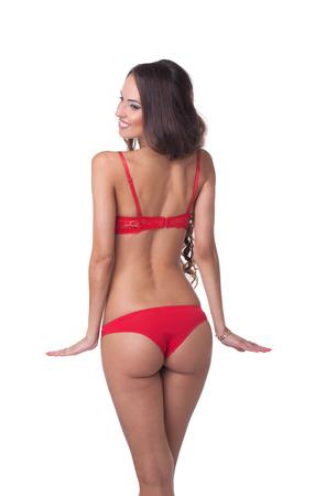 red bra: Rear view of smiling slender model in red lingerie